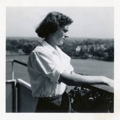 I love this picture of Joan. Taken in the 1950s on the balcony of her new flat at the Fitzhugh Estate. Dressed in her crisp whit